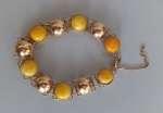 Złota bransoletka z bursztynami