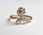 Złoty pierścionek z brylantem i diamentami